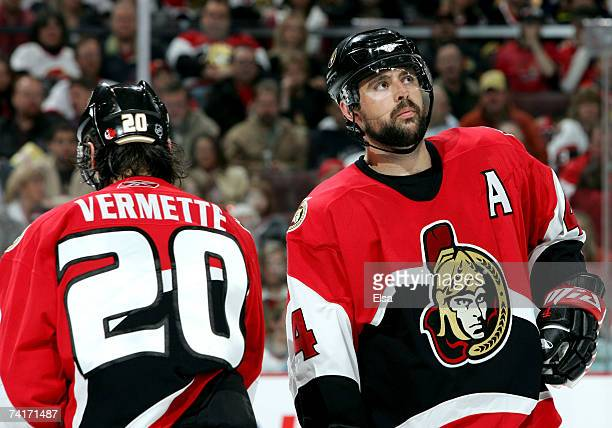 Chris Phillips of the Ottawa Senators looks up at the scoreboard near teammate Antoine Vermette in the final minutes of the third period before the...