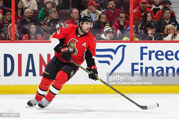 Chris Phillips of the Ottawa Senators skates against the New York Islanders during an NHL game at Canadian Tire Centre on December 4, 2014 in Ottawa,...
