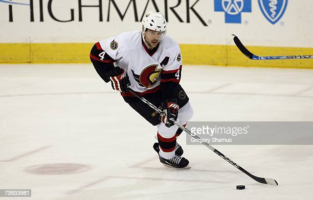Chris Phillips of the Ottawa Senators skates with the puck against the Pittsburgh Penguins in game 4 of the Eastern Conference Quarterfinals during...