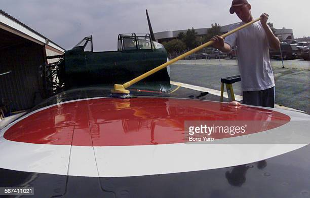 Chris Phillips who works for Pete Regina Aviation at Van Nuys Airport gets to wash off a Japanese Zero fighter Plane that was damaged when it crashed...