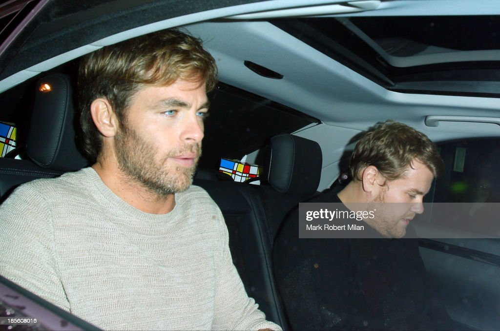Chris Pine and James Corden at the Groucho club on October 22, 2013 in London, England.