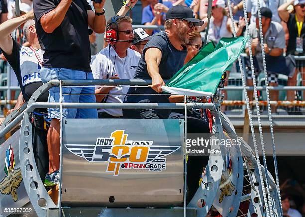 Chris Pine waves the green flag to start the Indy 500 at the Indianapolis Motor Speedway on May 29 2016 in Indianapolis Indiana