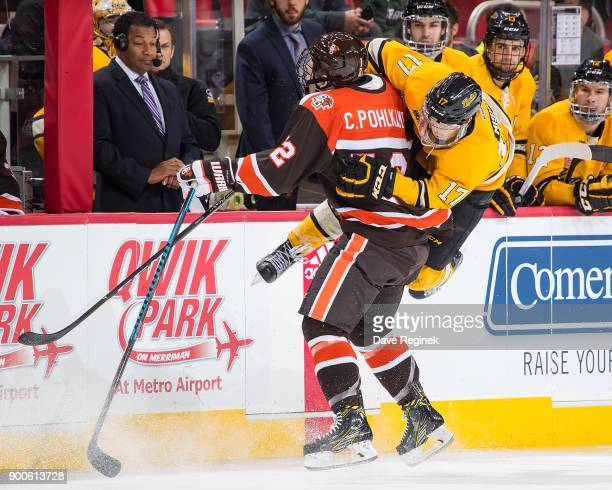 Chris Pohlkamp of the Bowling Green Falcons body checks Justin Misiak of the Michigan Tech Huskies during the championship game of the Great Lakes...