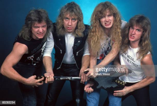 Chris Poland Gar Samuelson Dave Mustaine and David Ellefson of the heavy metal band Megadeth pose for a portrait holding a guitar in 1986 in New York...