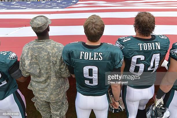 Chris Polk Nick Foles Matt Tobin and Brent Celek of the Philadelphia Eagles stand for the national anthem at Lincoln Financial Field on November 17...