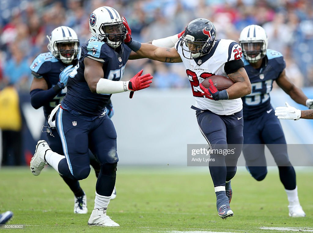Chris Polk #22 of the Houston Texans attempts to break a tackle attempt by Zach Brown #55 of the Tennessee Titans at LP Field on December 27, 2015 in Nashville, Tennessee.