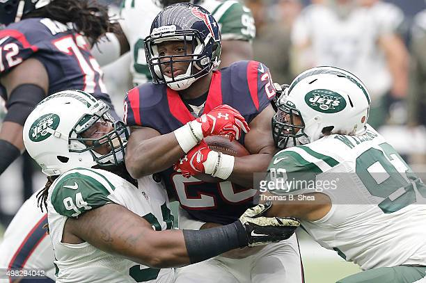 Chris Polk of the Houston Texans is tackled by Damon Harrison and Leonard Williams of the New York Jets in the first quarter on November 22 2015 at...