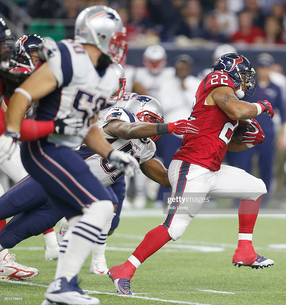Chris Polk #22 of the Houston Texans rushes against the New England Patriots in the third quarter on December 13, 2015 at NRG Stadium in Houston, Texas.