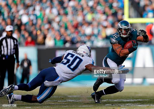 Chris Polk of the Philadelphia Eagles attempts to get by Zaviar Gooden of the Tennessee Titans in the first quarter during a football game at Lincoln...