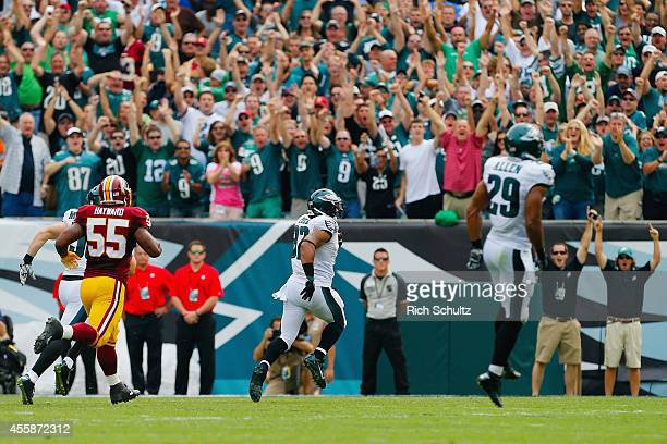 Chris Polk of the Philadelphia Eagles returns a kickoff running 102 yards for a first quarter touchdown against the Washington Redskins at Lincoln...