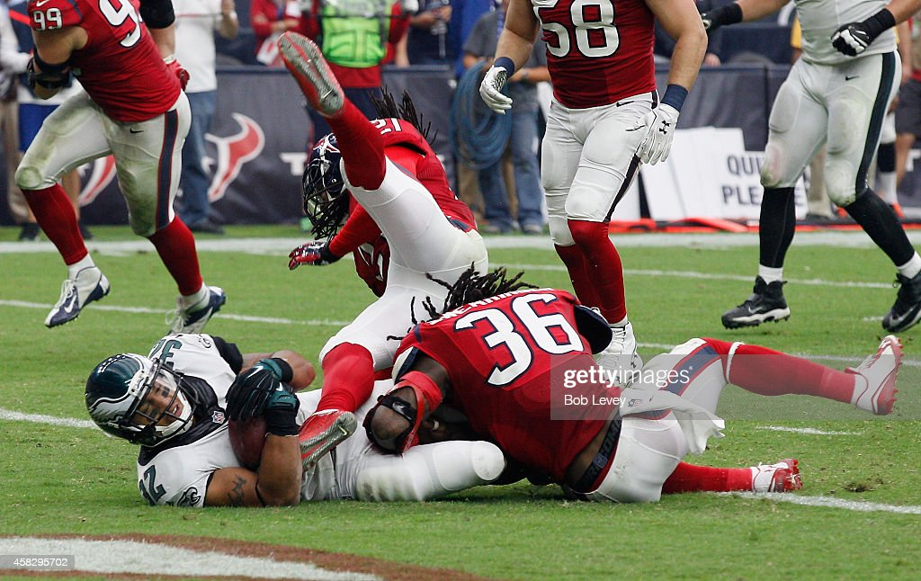 Chris Polk #32 of the Philadelphia Eagles scores as D.J. Swearinger #36 of the Houston Texans is unable to keep him out of the endzone at Reliant Stadium on November 2, 2014 in Houston, Texas.