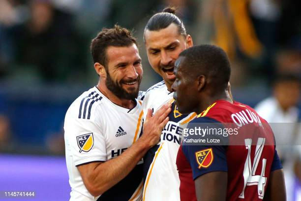 Chris Pontius and Zlatan Ibrahimovic of Los Angeles Galaxy celebrate Ibrahimovic's goal as he yells at Nedum Onuoha of Real Salt Lake during the...