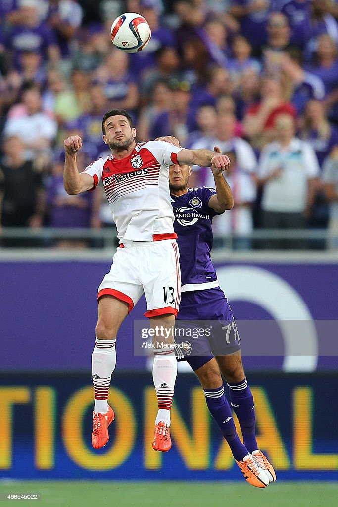 Chris Pontius #13 of D.C. United and Aurelien Collin #78 of Orlando City SC fight for the ball during a MLS soccer match between DC United and the Orlando City SC at the Orlando Citrus Bowl on April 3, 2015 in Orlando, Florida.