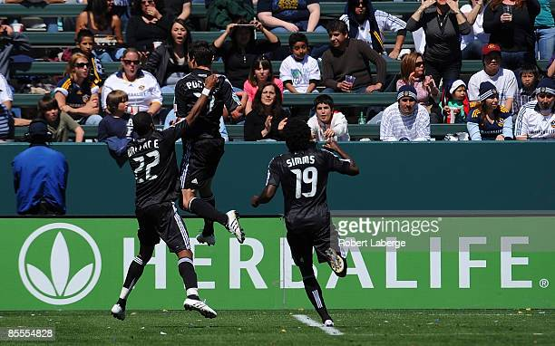Chris Pontius of DC United celebrates with his teammates after scoring against the Los Angeles Galaxy at the Home Depot Center on March 22 2009 in...