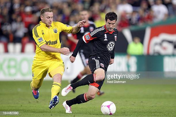 Chris Pontius of DC United controls the ball against Danny O'Rourke of the Columbus Crew at RFK Stadium on October 20 2012 in Washington DC