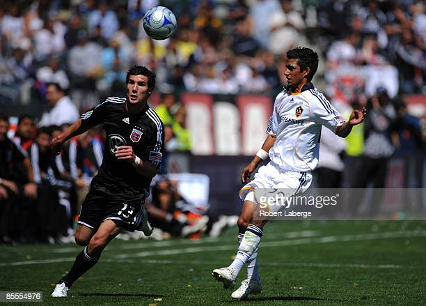 Chris Pontius of DC United fights for the ball with AJ DeLaGarza of the Los Angeles Galaxy at the Home Depot Center on March 22 2009 in Carson...