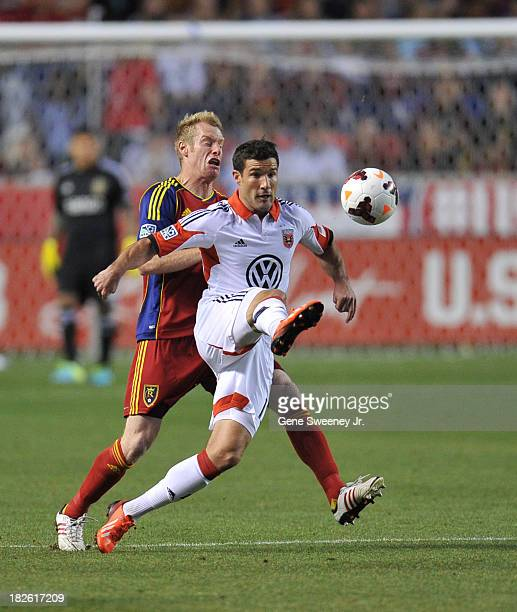 Chris Pontius of DC United kicks the ball away from Nat Borchers of Real Salt Lake at Rio Tinto Stadium October 1 2013 in Sandy Utah