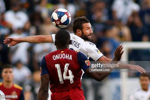 Chris Pontius of Los Angeles Galaxy and Nedum Onuoha of Real Salt Lake go up for a header during a game at Dignity Health Sports Park on April 28...
