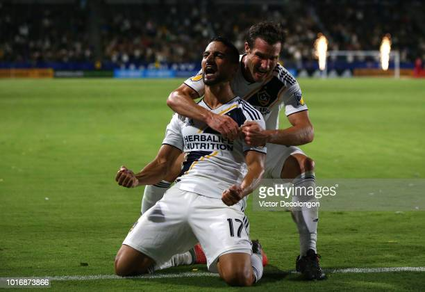 Chris Pontius of Los Angeles Galaxy hugs teammate Sebastian Lletget as Lletget celebrates his goal during the second half of the MLS match against...