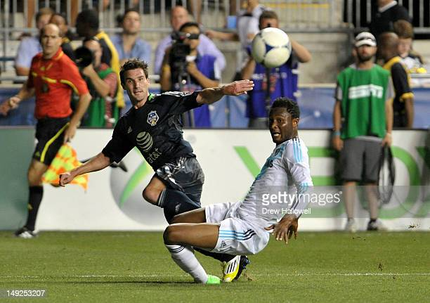 Chris Pontius of MLS All-Stars looks to cross the ball against Mikel John Obi of Chelsea during the 2012 AT&T MLS All-Star Game at PPL Park on July...