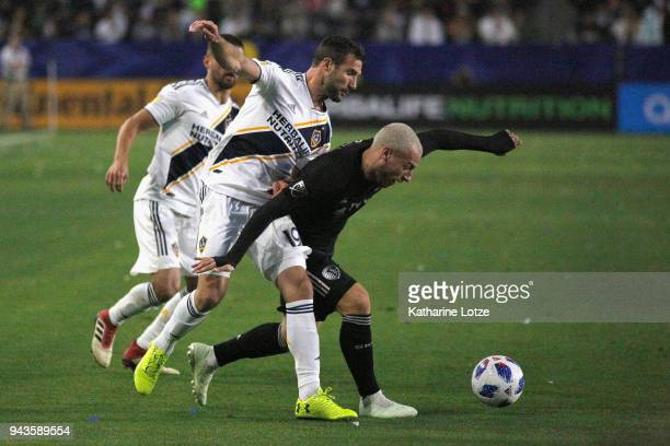 Chris Pontius of the Los Angeles Galaxy compete for the ball with Yohan Croizet of Sporting Kansas CIty at StubHub Center on April 8 2018 in Carson...