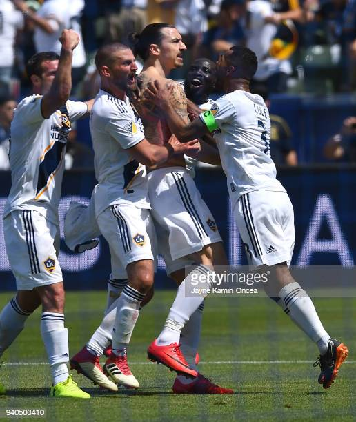 Chris Pontius Perry Kitchen Ema Boateng and Ashley Cole celebrate after a goal by Zlatan Ibrahimovic of Los Angeles Galaxy in the second half of the...