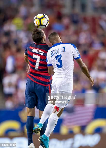 Chris Pontius vs Martinique Antoine JeanBaptiste for a header during the CONCACAF Gold Cup soccer match between USA and Martinique on July 12 2017 at...