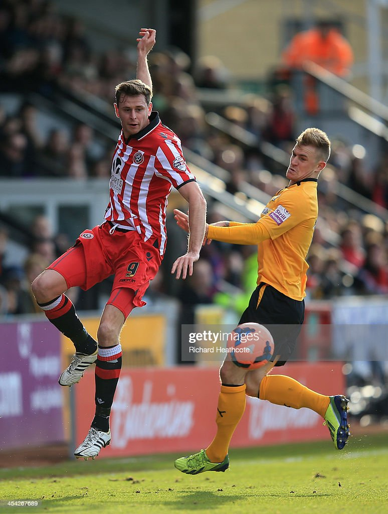 Chris Porter of Sheffield United is challenged by Richard Tait of Cambridge United during the FA Cup Second Round match between Cambridge United and Sheffield United at the Abbey Stadium on December 8, 2013 in Cambridge, Cambridgeshire.