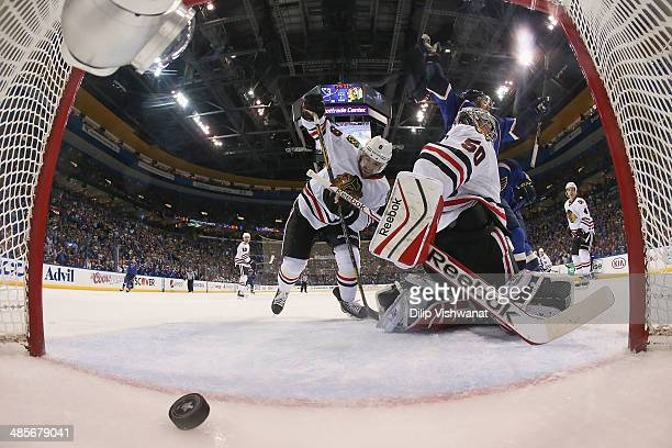 Chris Porter of the St Louis Blues celebrates after Corey Crawford and Nick Leddy of the Chicago Blackhawks give up the gamewinning goal in Game Two...