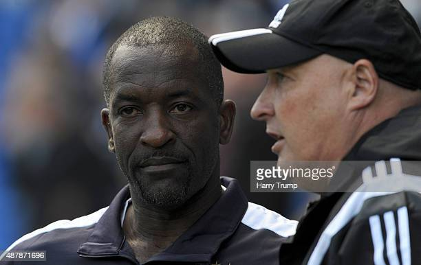 Chris Powell manager of Huddersfield chats with Russell Slade manager of Cardiff City during the Sky Bet Championship match between Cardiff City and...