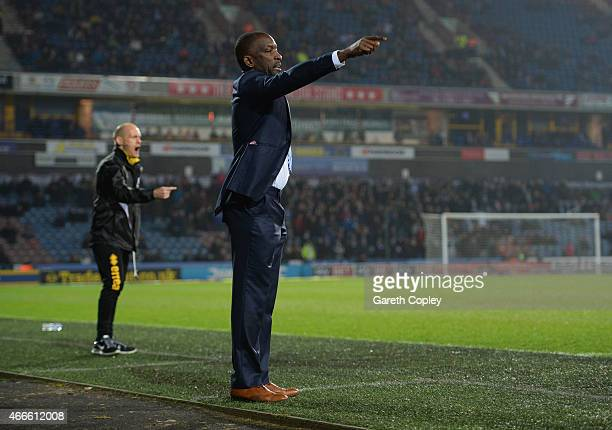 Chris Powell manager of Huddersfield Town and Alex Neil manager of Norwich City give isntructions during the Sky Bet Championship between...