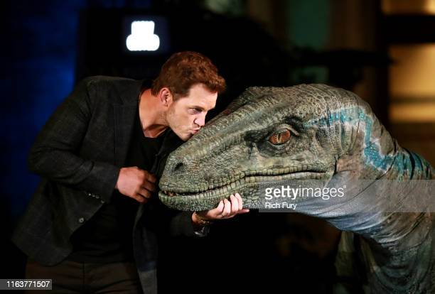 Chris Pratt and Blue the velociraptor interact onstage at the grand opening celebration of 'Jurassic World -The Ride' at Universal Studios Hollywood...