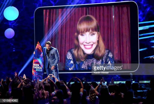 Chris Pratt and Bryce Dallas Howard accept the Choice Summer Movie Actor award onstage during FOX's Teen Choice Awards at The Forum on August 12 2018...