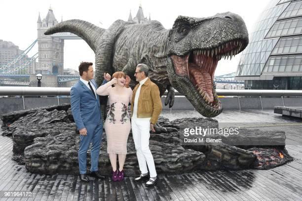 Chris Pratt Bryce Dallas Howard and Jeff Goldblum pose during the 'Jurassic World Fallen Kingdom' photocall at London Bridge on May 24 2018 in London...