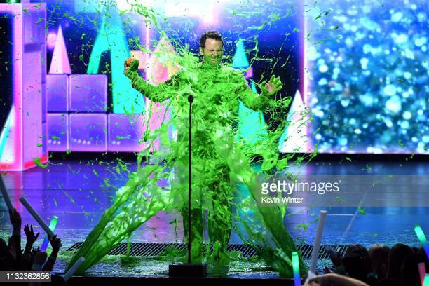 Chris Pratt gets slimed onstage with Favorite ButtKicker award for 'Jurassic World Fallen Kingdom' at Nickelodeon's 2019 Kids' Choice Awards at Galen...