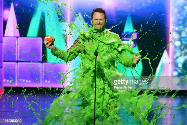 Chris Pratt gets slimed onstage with Favorite ButtKicker award for 'Jurassic World Fallen Kingdom' at Nickelodeon's 2019 Kids' Choice Awards at Galen...