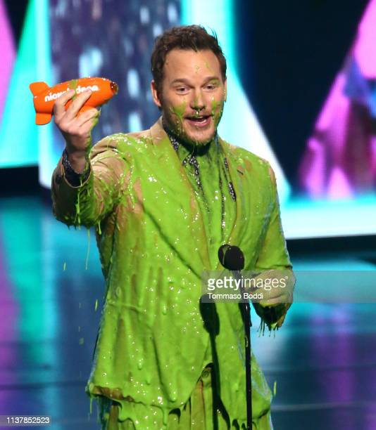 Chris Pratt reacts after getting slimed onstage with Favorite ButtKicker award for 'Jurassic World Fallen Kingdom' during Nickelodeon's 2019 Kids'...