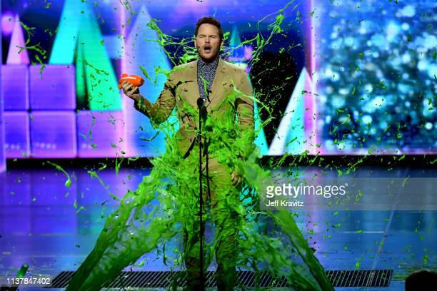 Chris Pratt reacts while getting slimed onstage at Nickelodeon's 2019 Kids' Choice Awards at Galen Center on March 23 2019 in Los Angeles California