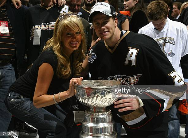 Chris Pronger of the Anaheim Ducks and wife Lauren smile as they pose with the trophy after the Ducks defeated the Ottawa Senators in Game Five of...