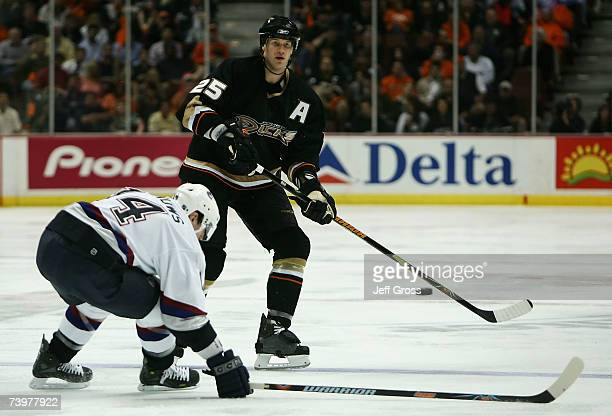 Chris Pronger of the Anaheim Ducks shoots the puck into the zone against Alex Burrows of the Vancouver Canucks during game one of the 2007 Western...