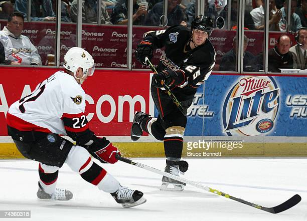 Chris Pronger of the Anaheim Ducks shoots the puck past Chris Kelly of the Ottawa Senators during the third period of Game Two of the 2007 Stanley...