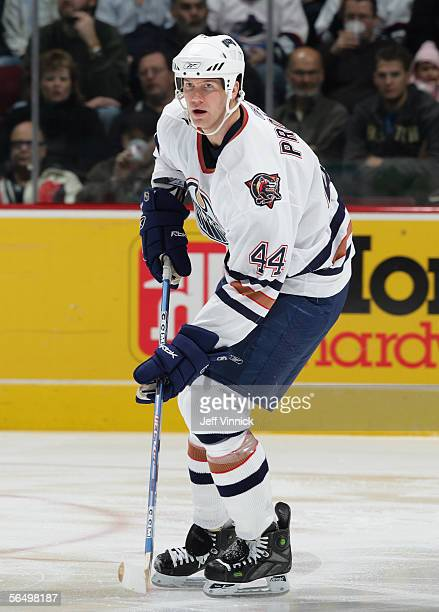 Chris Pronger of the Edmonton Oilers looks to set up a play against the Vancouver Canucks during their NHL game at General Motors Place on December...