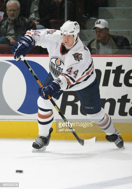 Chris Pronger of the Edmonton Oilers passes the puck against the Vancouver Canucks during the NHL game at General Motors Place on December 21, 2005...