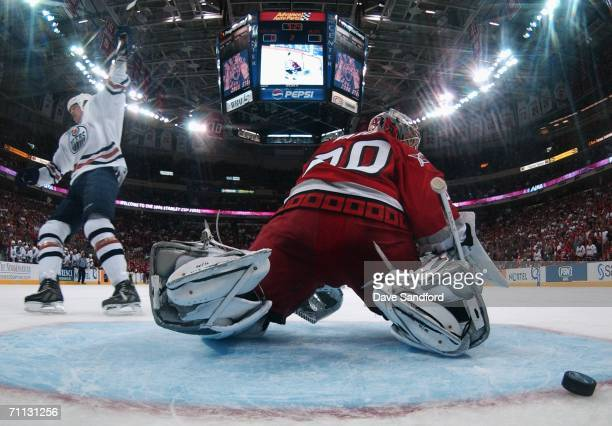Chris Pronger of the Edmonton Oilers scores a penalty shot goal against goaltender Cam Ward of the Carolina Hurricanes during the second period of...
