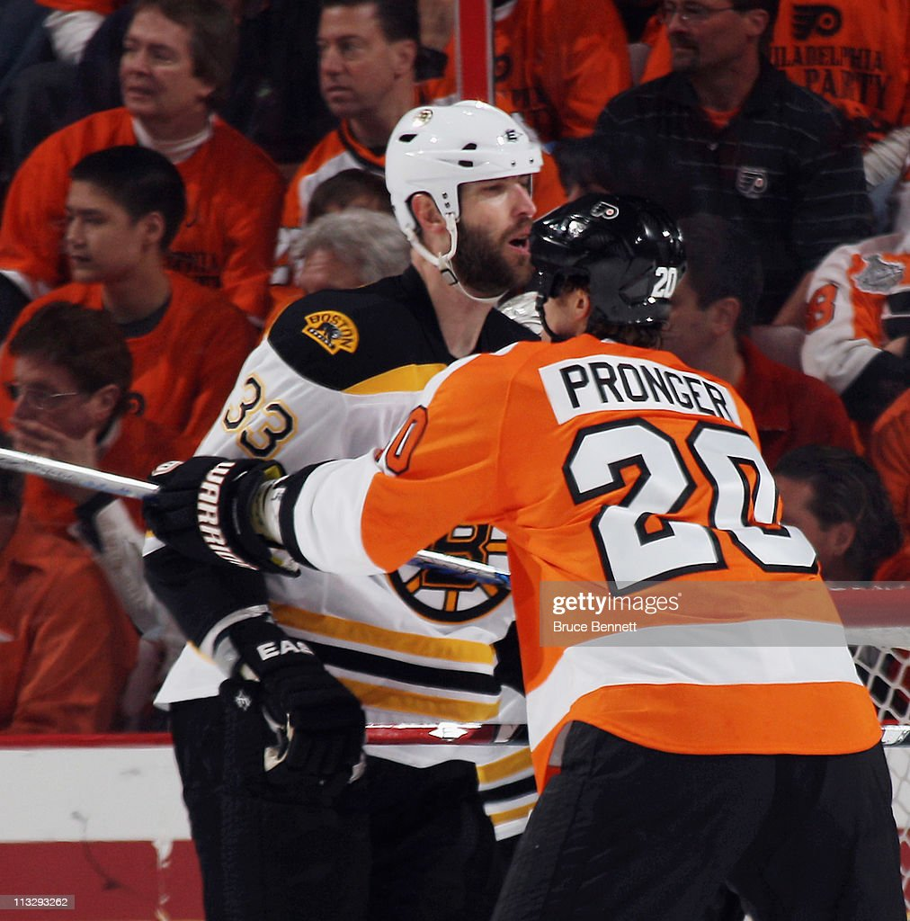 Chris Pronger #20 of the Philadelphia Flyers and Zdeno Chara #33 of the Boston Bruins battle in Game One of the Eastern Conference Semifinals during the 2011 NHL Stanley Cup Playoffs at the Wells Fargo Center on April 30, 2011 in Philadelphia, Pennsylvania. The Bruins defeated the Flyers 7-3.