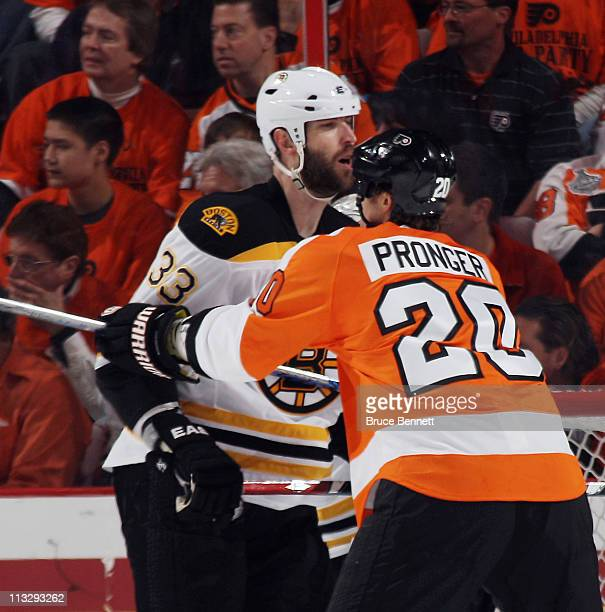 Chris Pronger of the Philadelphia Flyers and Zdeno Chara of the Boston Bruins battle in Game One of the Eastern Conference Semifinals during the 2011...