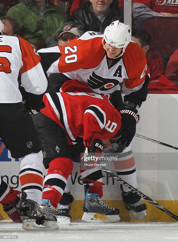 Chris Pronger of the Philadelphia Flyers hits Zach Parise of the New ... a86dd9435