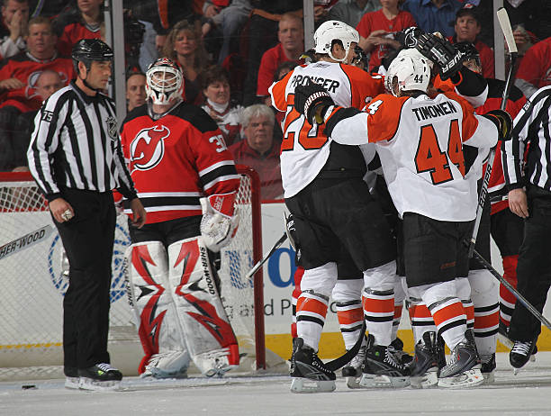 Chris Pronger  20 of the Philadelphia Flyers is hugged by teammates  following his second period 99a2ee8cc
