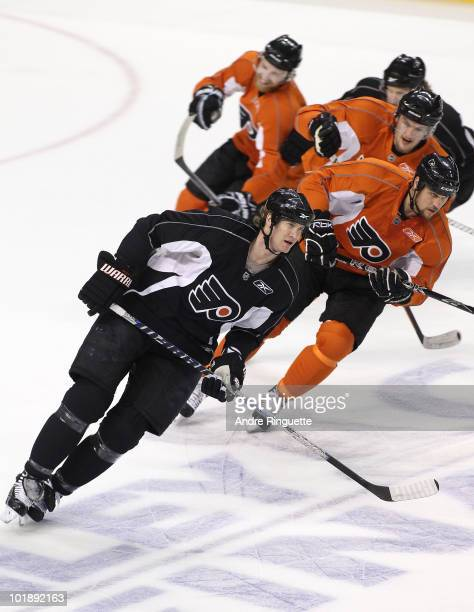Chris Pronger of the Philadelphia Flyers leads teammates in a skating drill during practice for the 2010 NHL Stanley Cup Final at Wachovia Center on...