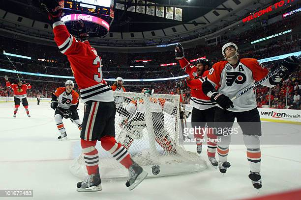 Chris Pronger of the Philadelphia Flyers reacts as Dave Bolland of the Chicago Blackhawks celebrates after scoring his team's second goal in the...